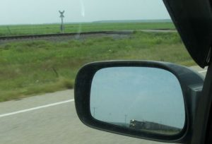 train in rear-view mirror