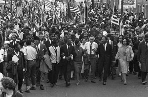 ON THE MOVE: Dr. Martin Luther King, lower right, holds hands with his wife, Coretta, during an Alabama march. -- PHOTOGRAPHER: Associated Press