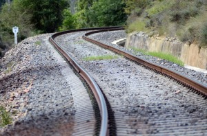 train tracks rounding a bend and disappearing