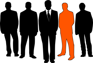 silhouettes of a group of five businessmen - one of the silhouettes is a different color