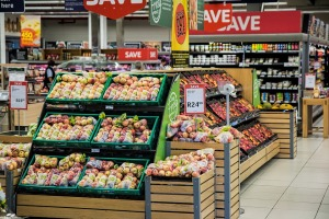 grocery store scene with shelves of produce