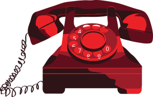 red vintage phone with rotary dial