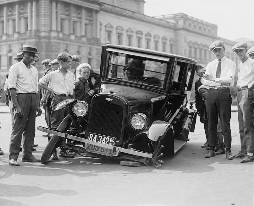 1923 broken down car with wheel off