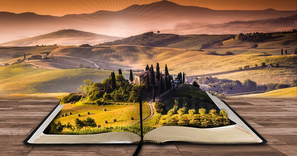 open book with a landscape scene in the pages
