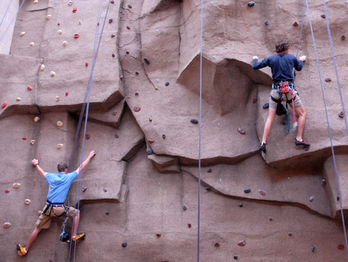 two rock climbers on climbing wall
