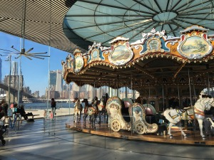 merry go round with city in background